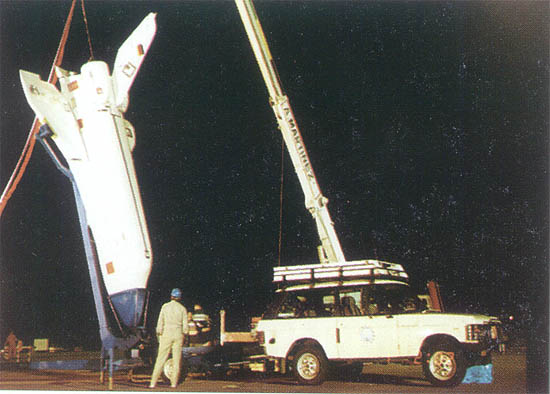 The FALKE vehicle being winch up by the crane acting as launch vehicle