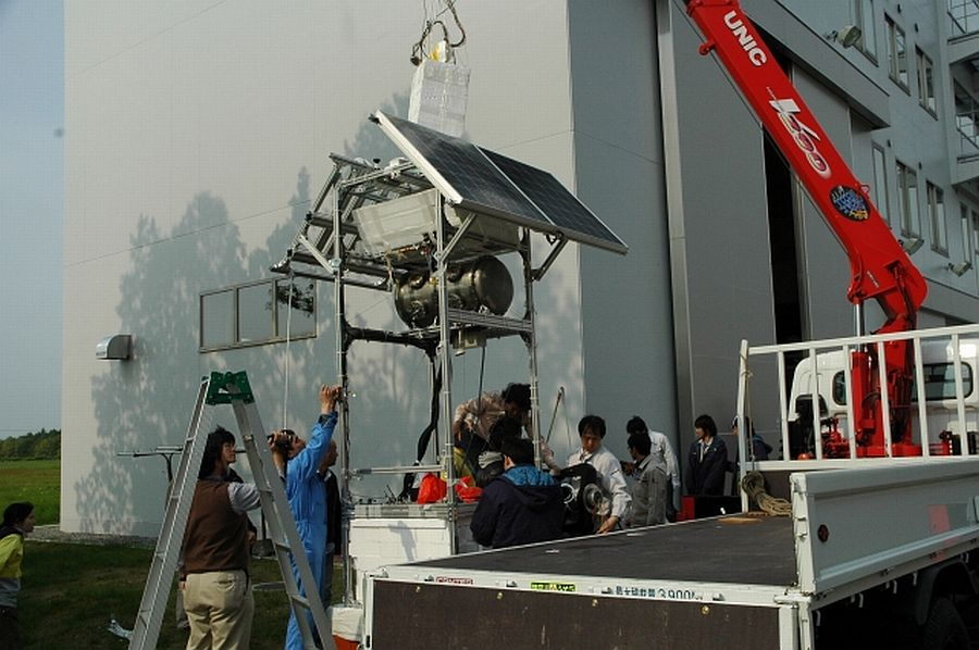 After the flight, the recovered telescope is examinated by the scientific team (Courtesy: JAXA)