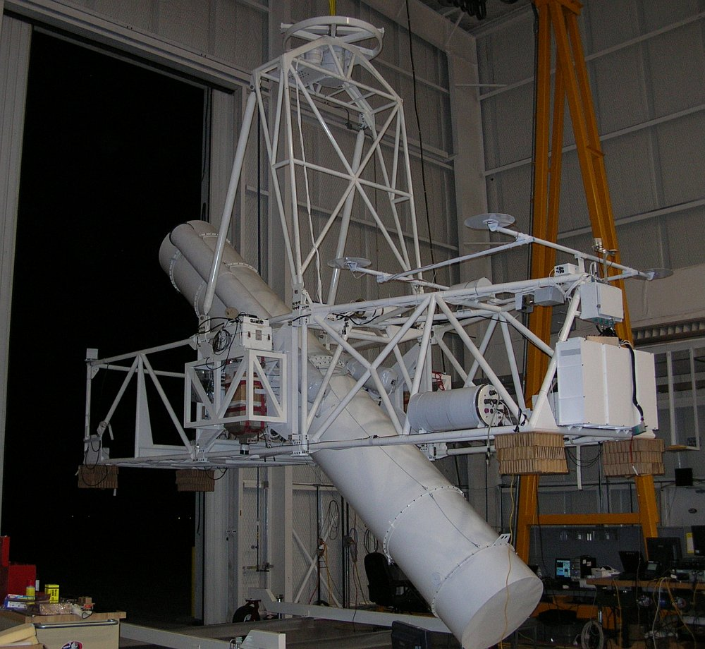 The image shows the HERO payload in the hangar doing pointing tests at the night sky with the optical bench deployed