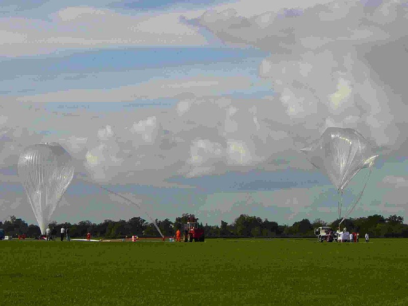View of the flight line and both balloons -main and auxiliary- fully inflated