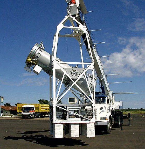 The MASCO telescope is hung up by a crane during a hang test in Nova Ponte Airport