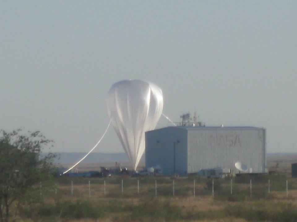 Distant view of the balloon almost fully inflated. In the foreground the NASA highbay building in Fort Sumner (Picture: Ross hays)