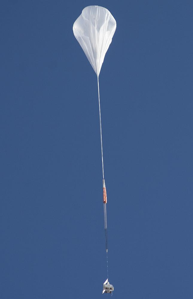 Initial ascent phase. A large portion of the balloon is left unfilled so it can expand as it ascends into the thinner air of the stratosphere. (Photo by Carlye Calvin, UCAR)