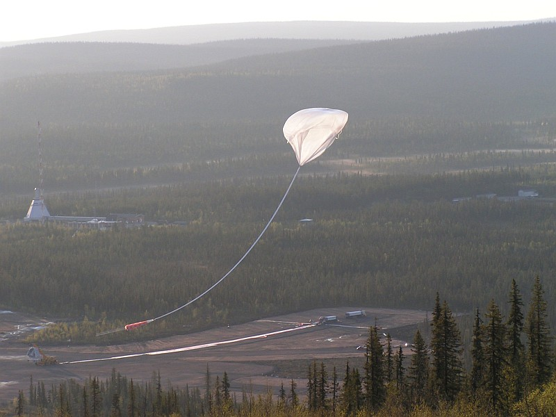 View of the release of the balloon from a nearby hill