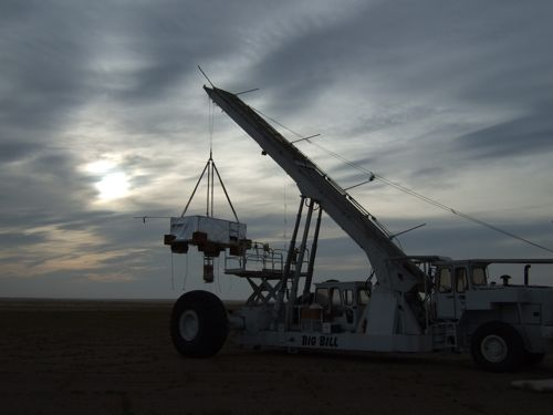 The CREST payload hanging against an overcast sky (Image Courtesy: Eric Bellm)
