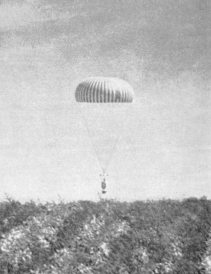 The telescope, returning to the ground under its parachute. A rare image taken at the end of Flight C