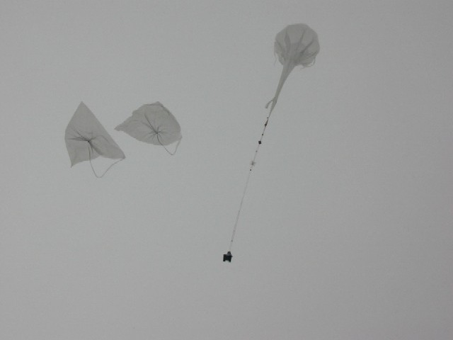 The main balloon hold the payload while the auxiliary balloons are detached from the gondola and fall in the launch pad