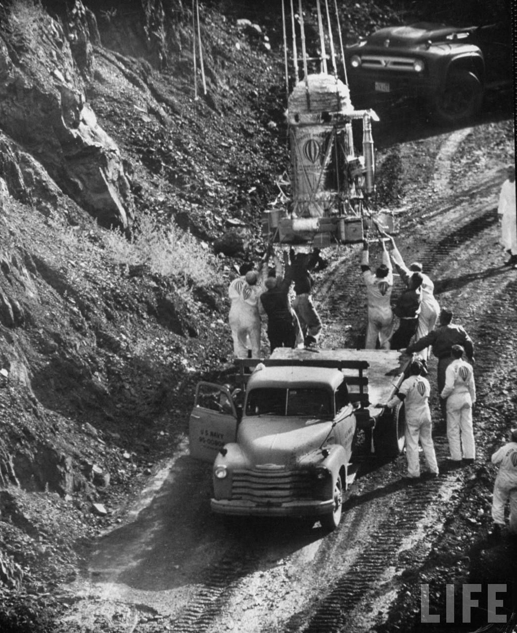 Winzen's technician moving the gondola in the back of a flat truck just before the launch to avoid the capsule hitting the rim of the mine crater (Image courtesy of LIFE archive on Google)