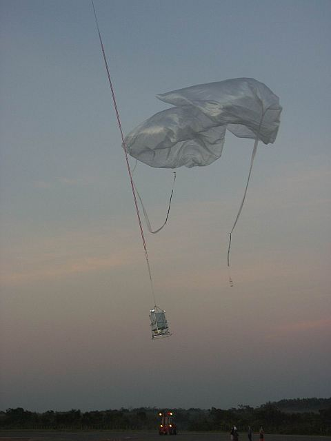 The main balloon pull off the payload and the auxiliary balloons are cut loose